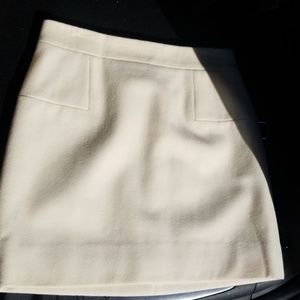 Cream colored J Crew mini skirt